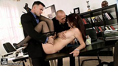Skinny brunette broad gets fucked by her two bosses in the office