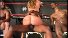 With a black dick in each hole, the athletic blonde sighs with pleasure