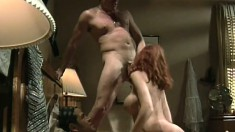 A redhead slut with a great rack gets roughed up by a pair of guys