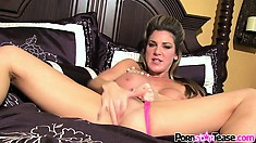 Kayla Paige is posing for the camera and then fingers her hole looking at you