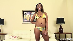 Tori Taylor models her fine ebony body in a tight bathing suit