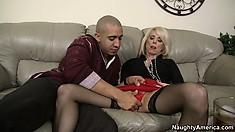 Mature blonde Jodie Stacks gets a foot massage and more from a young Latin hunk