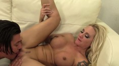 Kinky blonde vamp Alexis Malone tickles her lover's ass with her tongue and gets pounded hard on the couch