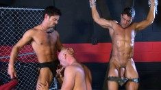Blindfolded and chained stud gets his cock stroked and sucked in gay bondage