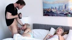 Two petite young blondes getting nailed deep on the bed by a hung guy