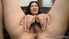 Playing with the fuzzy hair on the pubis of a gorgeous Japanese babe