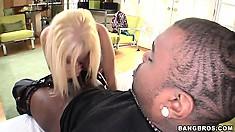 Busty blonde slut gets her knees to work on a big black shaft