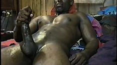 Muscled black stud grabs his big mamba snake and gives it a good jerk