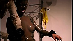 Slave is wrapped in latex and given a ball gag to ready her for sex
