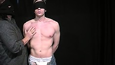 Blindfolded young stud has a guy pleasing his cock and fingering his butt hole