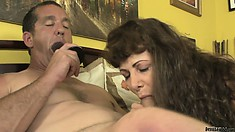 Naughty daddy sucking on a dildo while his wife is blowing his cock