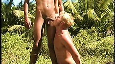 Horny black guy gets his ass fucked by a white stud in the outdoors