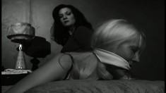 Ava Lalonde in some BDSM action and is tied and gagged in black and white