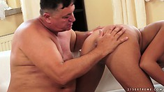 Kinky old fatso getting his asshole stimulated by a young blonde