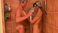 Cute blonde with big boobs takes a shower and then fucks an older guy