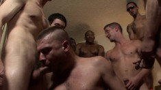 Muscled stud has a group of horny guys nailing his tight ass bareback