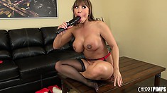 Nasty whore Ava Devine in black stockings rubs her aching fanny