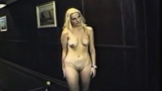 Slender Blonde with tiny boobs does striptease outdoor