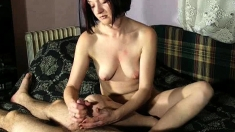 Brunette Milf Has A Smoke While Giving A Handjob