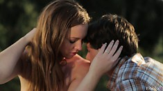 Cute teenage couple make sweet love out in the open on a sheet