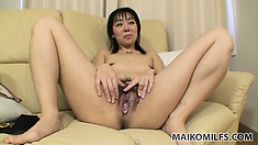 The hot milf drops her pink underwear to reveal her tiny tits and her sweet hairy cunt
