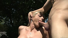 Gorgeous blonde cougar bangs her son in law out in the backyard