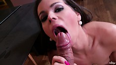 She's so horny that she rubs her clit with a mouthful of dick