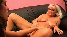 Two lusty mature lesbians use their tongues to make each other come