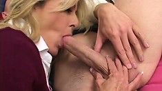 Two younger guys seduce a busty blonde Milf and give her a messy facial