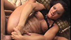 Wild brunette fingers her fiery cunt while a hard dick pounds her ass