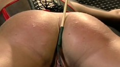 Tied up chick can do nothing to resist this nasty pussy punishment