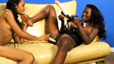 Naughty black lesbians in sexy lingerie having fun with a few sex toys